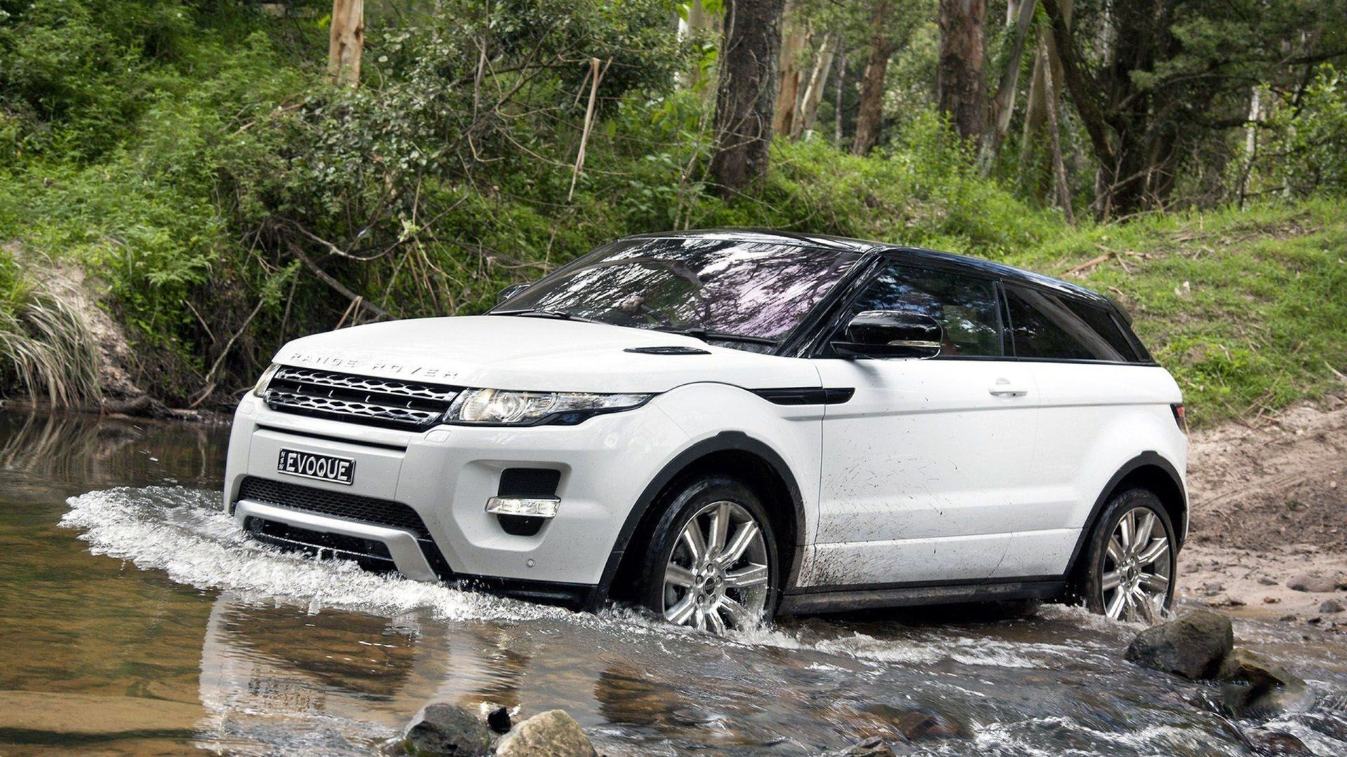 2020 land rover range rover evoque white offroading in swamp