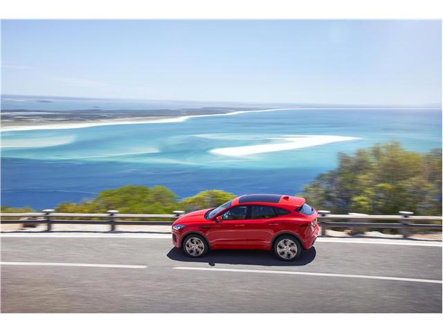 2020 Jaguar E-Pace side view driving at sea side